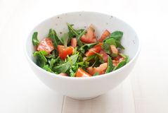 Salad with tomatoes and arugula Royalty Free Stock Photo