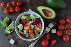 Salad with tomatoes avocado and feta cheese Stock Photo