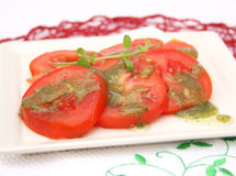 Salad of tomatoes with basil pesto Royalty Free Stock Image