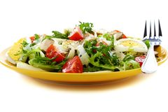 Salad with tomatoes, cheese and chicken in a yello Stock Photos