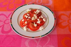 Salad of tomatoes with cheese Stock Photo