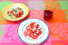 Salad of tomatoes with cheese Royalty Free Stock Images