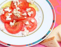 Salad of tomatoes with cheese Stock Photos