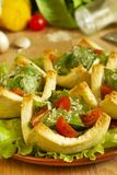 Salad with tomatoes and cheese in tartlets Stock Photos
