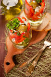 Salad of tomatoes, cucumbers, cheese, olives and herbs Royalty Free Stock Photo