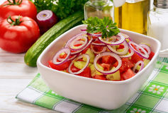 Salad with tomatoes, cucumbers and onion. Stock Image