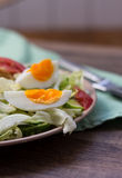 Salad with tomatoes, egg, cucumbers. Summer salad with tomatoes, egg, cucumbers Stock Photo
