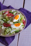 Salad with tomatoes, egg, cucumbers. Summer salad with tomatoes, egg, cucumbers Royalty Free Stock Photography