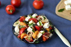 Salad with tomatoes, feta chees, apricots and olives Royalty Free Stock Image