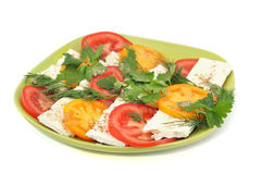 Salad with tomatoes, feta cheese with parsley and dill Royalty Free Stock Image