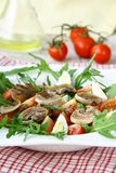 Salad with tomatoes and fried mushrooms Stock Images