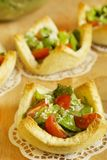 Salad with tomatoes and grated cheese in tartlets Stock Photo