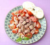 Salad of tomatoes with liver Stock Images
