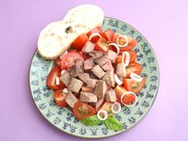 Salad of tomatoes with liver Royalty Free Stock Photos