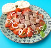 Salad of tomatoes with liver Stock Photo