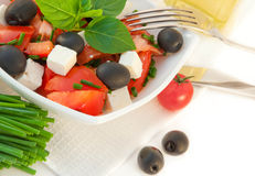 Salad from tomatoes, olives , a Royalty Free Stock Photo