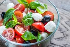 Salad with tomatoes, olives, mozzarella and basil Royalty Free Stock Photography