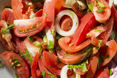 Salad from tomatoes with onions and greens Royalty Free Stock Photography