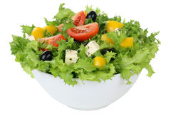 Salad with tomatoes, paprika and olives in bowl isolated. Salad with tomatoes, paprika, Feta cheese and olives in bowl isolated Royalty Free Stock Photo