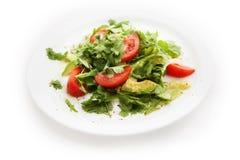 Salad with tomatoes, parsley, avocado on white background Stock Image
