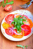 Salad of tomatoes, red onion and arugula Stock Images