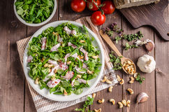 Salad with tomatoes and roasted nuts Royalty Free Stock Photo