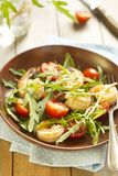 Salad with tomatoes and shrimps Stock Photo