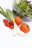 Salad, tomatoes, spring onions and orange pepper isolated on whi Royalty Free Stock Photo