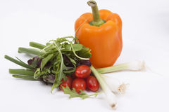 Salad, tomatoes, spring onions and orange pepper isolated on whi Royalty Free Stock Image