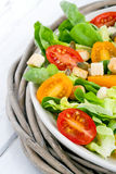 Salad with tomatos and croutons on a plate Stock Image
