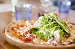 Salad-topped pizza Stock Images