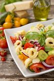 Salad with tortellini pasta. Tomato, Green Pepper and Cucumber Stock Images
