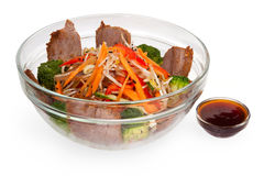 Salad in a transparent plate with meat and cabbage. Royalty Free Stock Photos