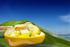 Salad with tropical fruits along the tropical sea. A salad with tropical fruits along the tropical sea Royalty Free Stock Image