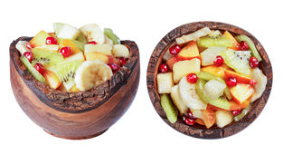 Salad of tropical fruits in a wooden bowl, isolate. Stock Photo