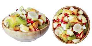 Salad of tropical fruits in a wooden bowl, isolate. Salad of tropical fruits in a wooden bowl, isolate on a white background in various angles Royalty Free Stock Photos