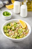 Salad with tuna, avocado, onion, egg and lemon. Spring healthy delicious lunch on light background. Salad with tuna, avocado, onion, egg and lemon. Spring stock photography