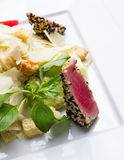 Salad with a tuna in sesame Stock Images