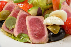 Salad with Tuna. Tasty fresh salad with tuna, olives, corn salad, eggs, cucumber and cherry tomato Royalty Free Stock Image