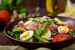 Salad with tuna, tomatoes, asparagus and onion Royalty Free Stock Image