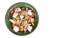 Salad of tuna with vegetables and cheese in a green bowl isolate Stock Photography