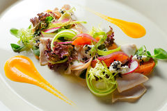 Salad with turkey fillet baked pumpkin and ricotta truffle sauce Stock Photo
