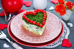 Salad on Valentine`s Day - layered salad shaped heart on a festi Stock Images