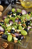 Salad with various grapes, goat cheese, purple onion, arugula and walnuts Royalty Free Stock Photography