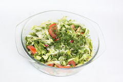 Salad. Vegetable Carving. Salad of tomatoes, cucumbers, cabbage young, radish, herbs and olive oil. Horizontal photo Royalty Free Stock Photos