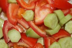 Salad. Vegetable salad with fresh tomatoes and cucumber. Top view stock photos