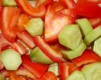 Salad. Vegetable salad with fresh tomatoes and cucumber. Top view stock photo