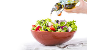 Salad. Vegetable salad. Spring vegetable salad.Fresh vegetable salad with tomatoes onion cheese and olives Royalty Free Stock Photo