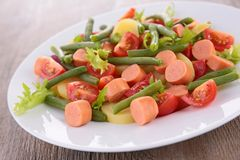 Salad with vegetable and sausages Stock Photos