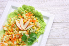 Salad of vegetables and apples royalty free stock image